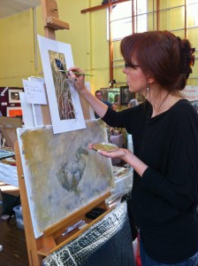 Claudia Hahn working on hand-guilding one of her exquisite prints.